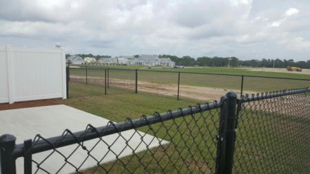 Vinyl Privacy and Vinyl Coated Chain Link for New Housing at Eglin AFB